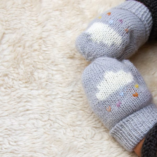 Button and Blue Mittens