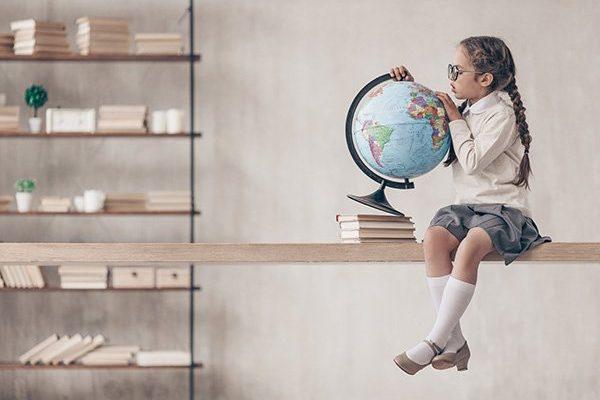 little-schoolgirl-with-a-globe-6JS53CG